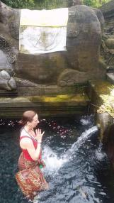 Purifying in the holy waters at the Pura Tirta Empul in Bali